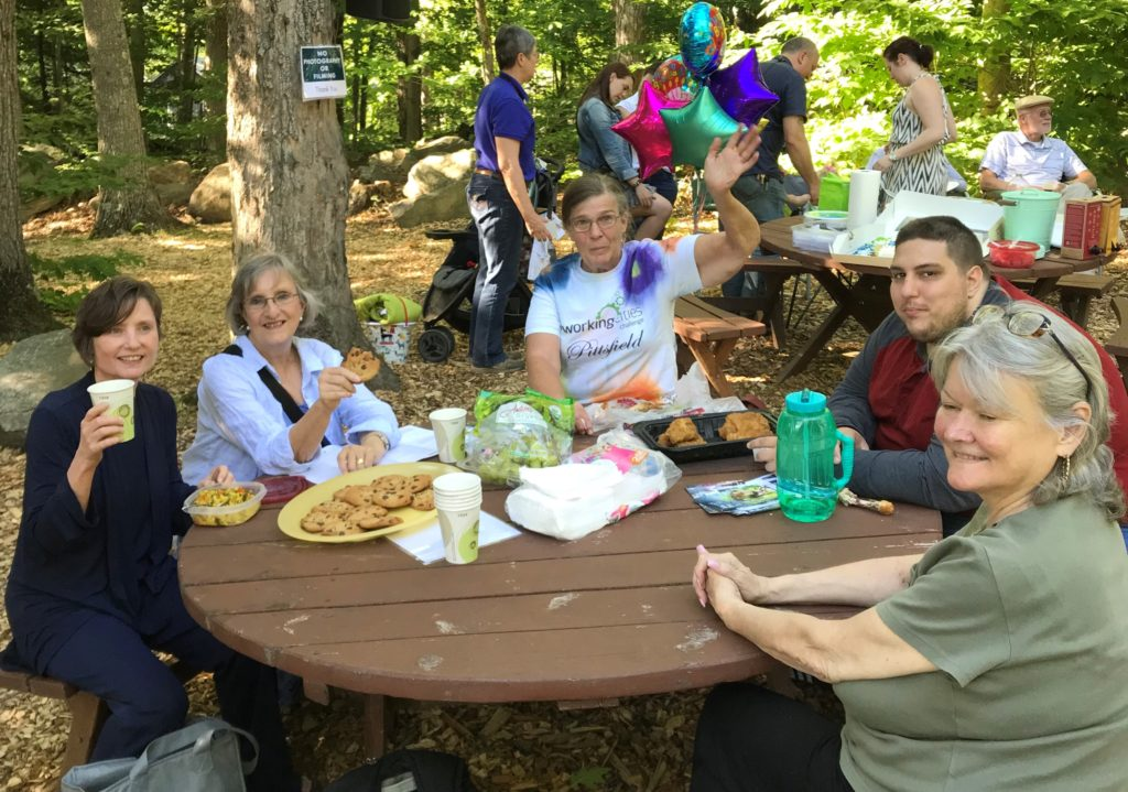 group of people at picnic table